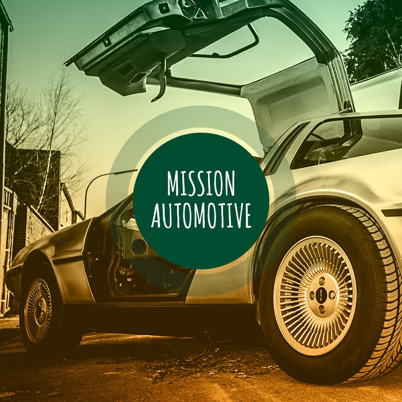 DeLorean mit der Aufschrift Mission Automotive.